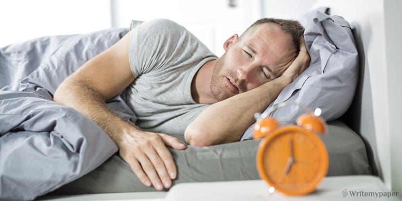 Sleepy Man in a Bed